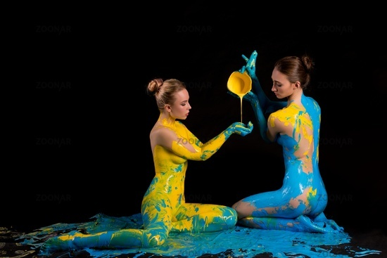 Creative process of naked women pouring paint to body