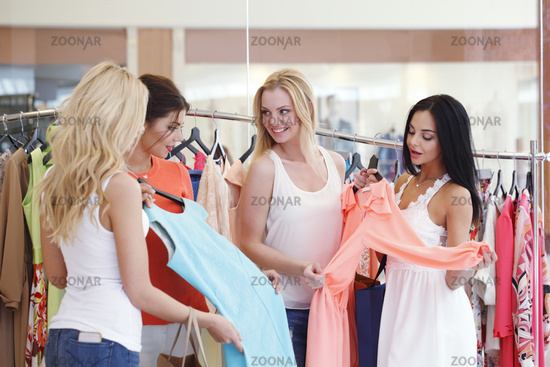 Women at sale choosing dress