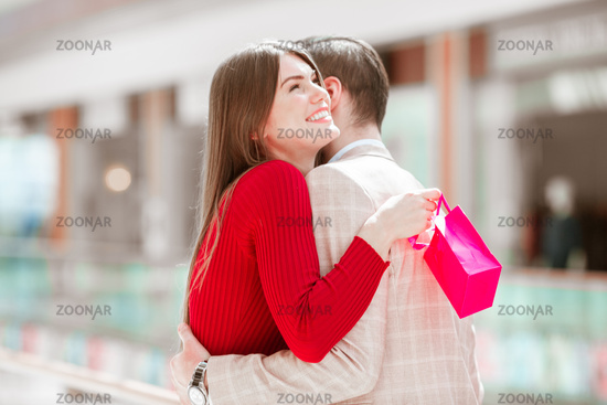 Woman hugging man for gift