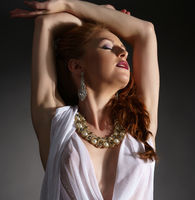 Image of seductive red-haired model touts jewels