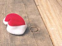 Tiny little hat of Santa on wood