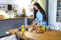 Young brunette woman preparing healthy breakfast