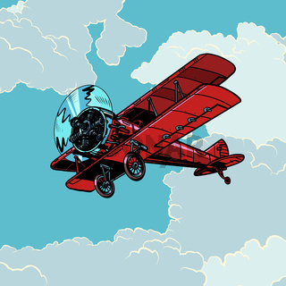 retro biplane plane flying in the clouds
