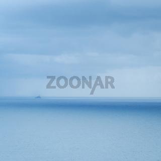 Lighthouse on an island in the atlantic ocean near mizen head ireland