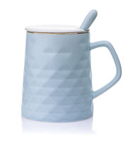 Side view of blue ceramic mug with lid