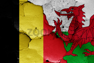 flags of Belgium and Wales painted on cracked wall