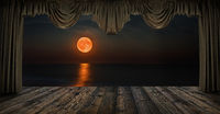 Night seascape with red moon through the window with curtains