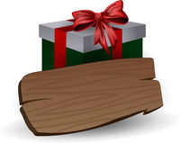 Holiday green gift box with bow and wooden board for inscriptions