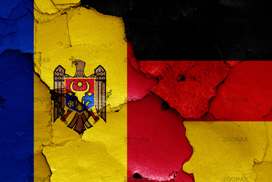 flags of Moldova and Germany painted on cracked wall