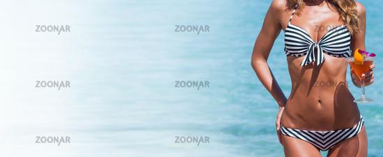 Woman in bikini with cocktail