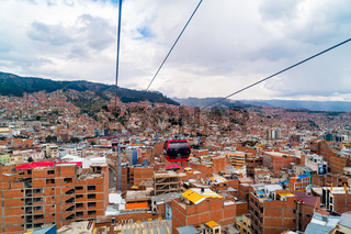 Aerial view of La Paz and Mi Teleferico cable cars carry passengers between the City of El Alto and La Paz in Bolivia