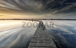 wooden path on water on big lake