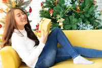 beautiful girl with christmas present gift box