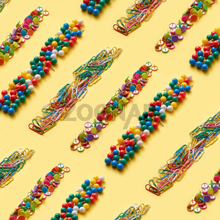 Stationery colorful pins and paper clips pattern.