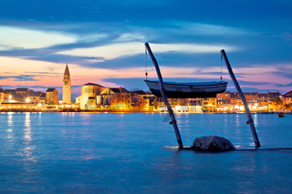 Town of Umag waterfront and coast evening view