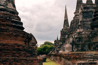 Historic Ancient City of Ayutthaya in Thailand with red brick and stone architecture - Buddhist monasteries in the old city of Siam