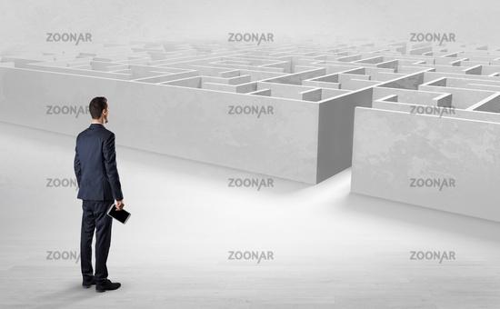 Businessman starting a labyrinth challenge