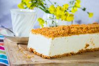 White cheesecake with orange crumbs