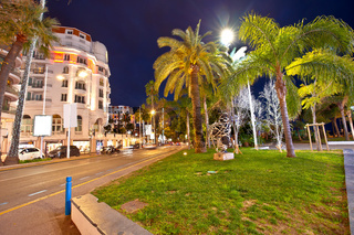 Cannes. Palm waterfront architectue in town of Cannes evening view