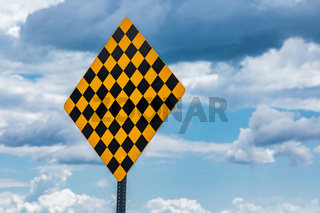 Canadian end of road sign against sky.