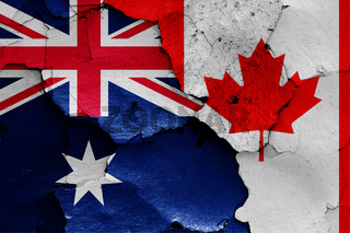 flags of Australia and Canada painted on cracked wall