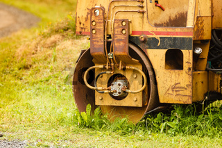 Combine harvester standing next to coutryside path