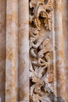 Humorous carving of lion with ice cream at the entrance to the new Cathedral in Salamanca