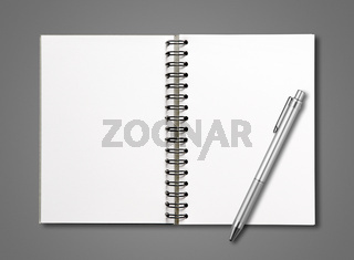 Blank open spiral notebook and pen isolated on dark grey