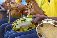 Tambourine, berimbau and others instruments player during presentation of Brazilian capoeira