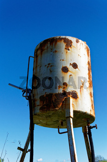Rusty old fuel tank on a farm