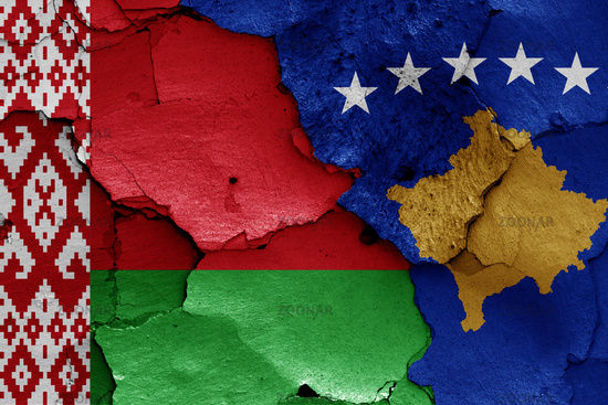 flags of Belarus and Kosovo painted on cracked wall