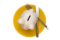 Piggy bank on the plate,isolated on white