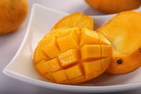 Fresh Organic Mango Fruit Sliced in a White Plate