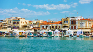Port and waterfront with small houses in Aegina town
