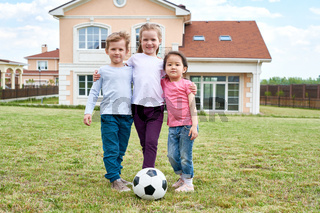 Three Kids Posing Outdoors