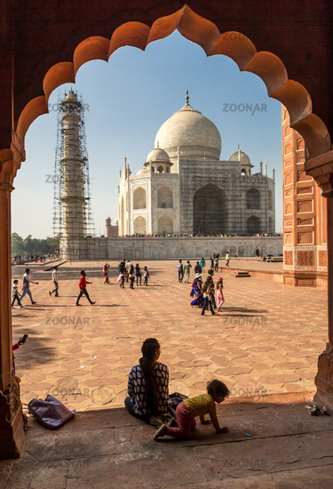 December 27th, 2016, Agra, India: A Woman with her kid sitting in front of the Taj Mahal