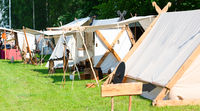 Tent camp and market stall at a medieval spectacle