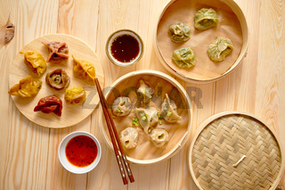 Traditional chinese dumplings served in the wooden bamboo steamer