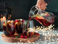 Winter sangria pouring in glasses, christmas table