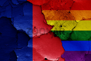 flags of Paris and LGBT painted on cracked wall