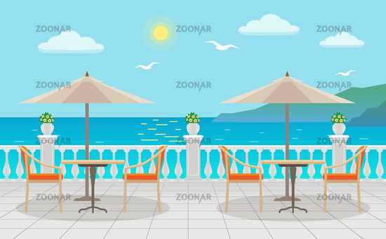 Cafe with tables under umbrellas with sea views on the street