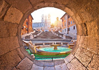 Spanish steps famous landmark of Rome morning view through stone window