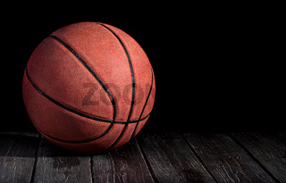 Basketball ball on a wooden floor
