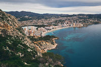 Aerial photo to salt lake and Mediterranean Seascape, Calpe or Calp resort spanish town, top view from Penon de Ifach or Penyal d'Ifac limestone huge rock located at Natural Park, Costa Blanca, Spain