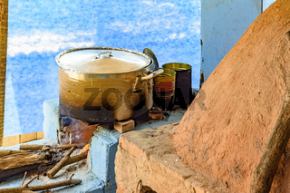 Rustic kitchen detail in the interior of Brazil with wood stove and oven of clay