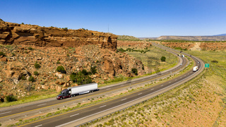 Vehicle Traffic moves along a Divided Highway in southwestern Desert Country