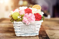 Close-up of beautiful flowers in box with HOME word