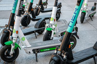 Electric scooter , escooter or e-scooter of the ride sharing company LIME and TIER on sidewalk
