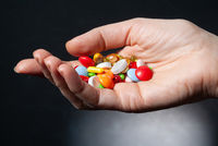 Different Drugs In A Hand