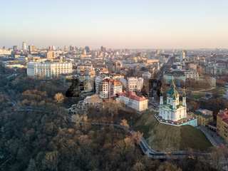 Panorama view of Podol and beautiful baroque St. Andrew's Church in Kiev city, Ukraine